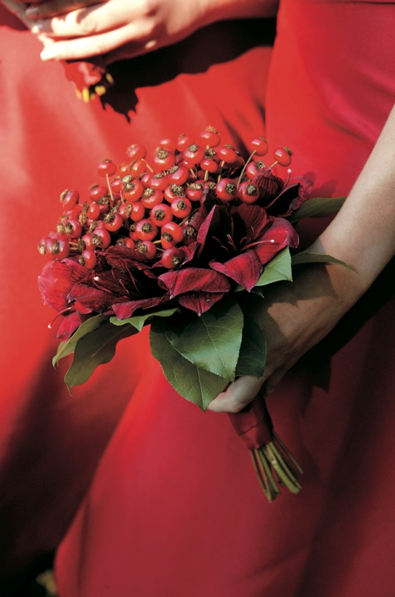 Red winter bouquet with berries and green leaves