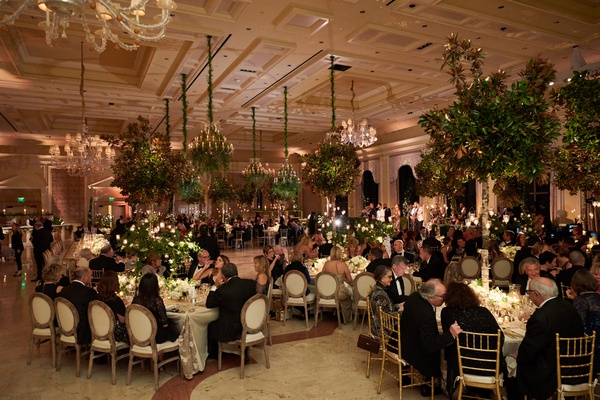 the breakers wedding reception with guests in ballroom full of greenery