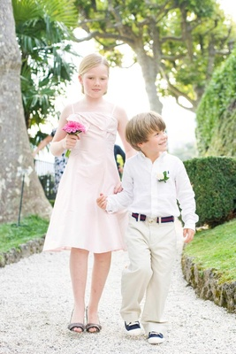 Ring bearer in khaki pants with blue Converse and preppy belt