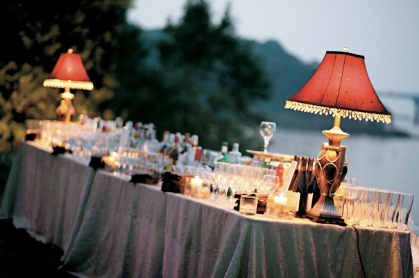 drinks served on table decorated with red lampshades