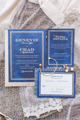 Blue and gold wedding paper divas wedding invitations gold bracelet and earrings reply rsvp card