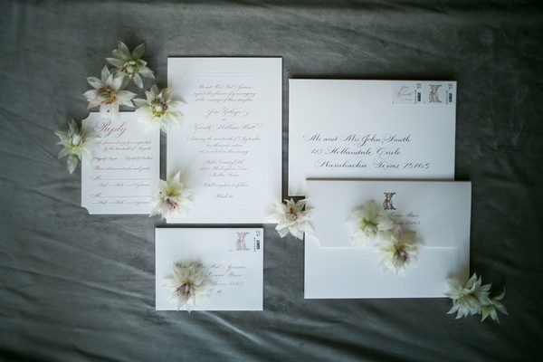 Wedding invitations with envelopes and flowers ivory white