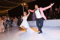 bride in mark zunino high-low wedding dress groom in salmon tuxedo jacket, choreographed first dance
