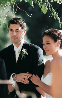 Bride and groom married in outdoor ceremony