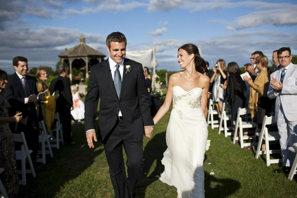 Couple walking away from birch chuppah