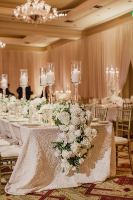 wedding reception long table textured linen white peony rose hydrangea flower runner gold candle