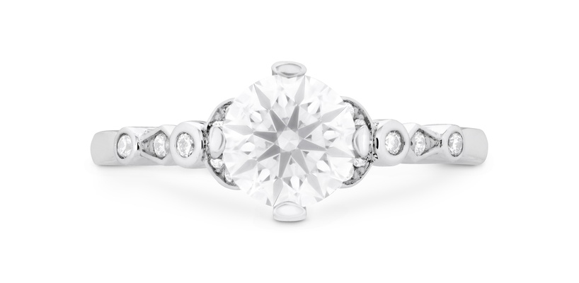 Hearts On Fire Cali Chic double petal bezel engagement ring with round center stone