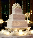 Three layer wedding cake with fresh roses