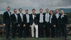 wedding in canada groom in white pants groomsmen in suits and light blue ties