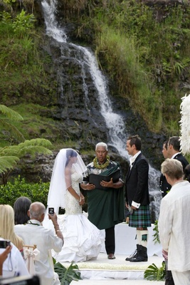 Angus Mitchell, co-owner of Paul Mitchell Systems, and his bride at their Hawaiian wedding ceremony