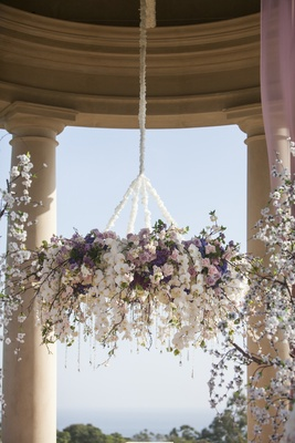 Orchids, roses, and crystals suspended from rotunda
