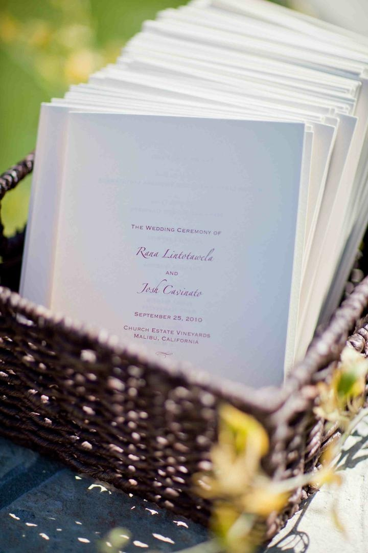 Wedding ceremony programs with a purple font