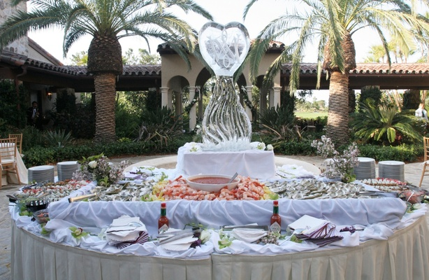 Seafood appetizer table with a monogrammed ice sculpture