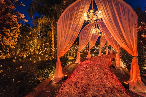 drapery over pathway flower petals marrakech morocco destination wedding ceremony opulent outdoor