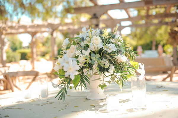 Low centerpiece Tim Lopez Jenna Reeves white flower outdoor wedding centerpiece with greenery