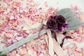 Jumping the broom tradition on petal aisle