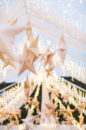 Open-air reception tent decorations and lighting