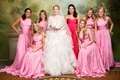 Bride with pink and cerise floor-length bridesmaids dresses