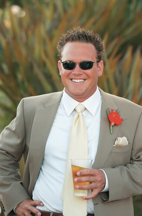 Groom with Ray Ban sunglasses and drink in hand