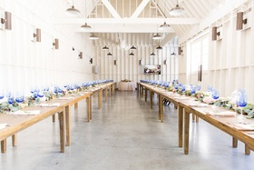 wedding reception lombardi house los angeles bright blue glassware cool lighting wood tables