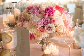 White, pink rose wedding reception centerpiece in mercury glass vase on table