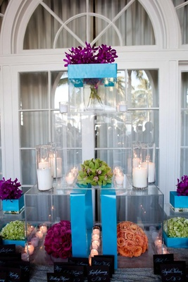 Bright blue acrylic boxes with candles and bright flowers