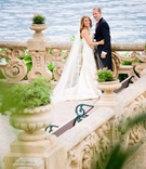 Wedding couple on lakefront terrace in Lake Como, Italy