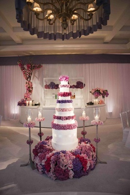 Six foot tall cake with purple rose layers