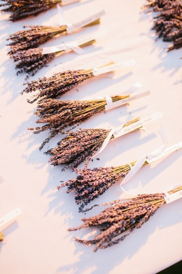 bohemian wedding with dried lavender bundles instead of traditional escort cards tied with tag