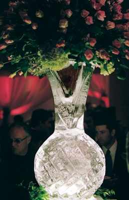 Roses and hydrangeas in vase made of ice
