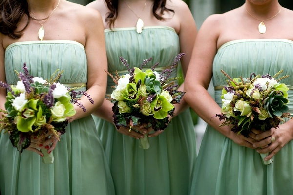 58fb1aab2cc ... Bridesmaids in light green dresses with bouquets of green and white  flowers ...