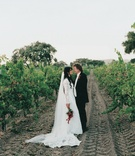 Long cathedral veil and lace bridal gown