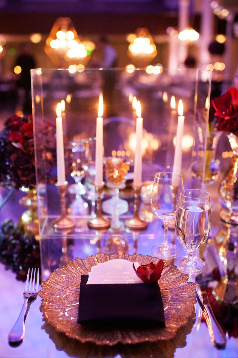 ... Guest place setting with gold charger on mirror table with red centerpiece and taper candlesticks ... & Greek Orthodox Church Ceremony + Glamorous Purple u0026 Gold Reception ...
