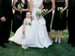 Ball gown flower girl dress with bell and tiara