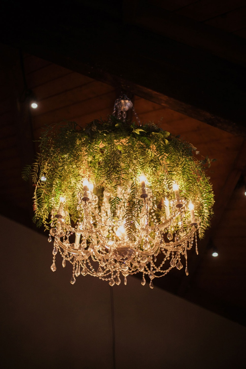 wedding decor crystal chandelier covered with greenery