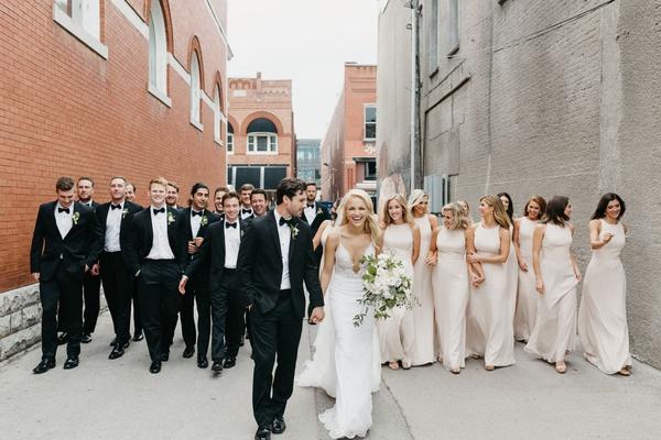bride and groom walking by industrial wedding venue at record arkansas wedding venue