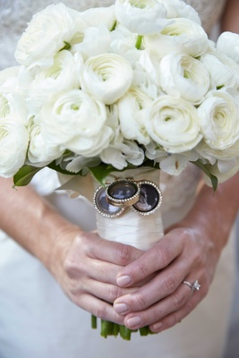 Bride holding white rose and ranunculus bouquet with three charms rhinestones old photos of family