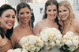 Bride and bridesmaid matching white bouquets