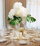 Destination wedding modern beach glam reception with sequin linen, orchid, hydrangea, philodendron