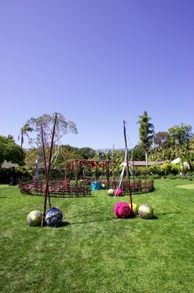 Outdoor wedding in the round on grass