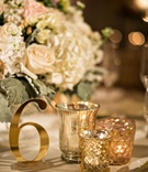 Wedding reception gold candle votives gold shiny shimmering table number cutout cut out number low