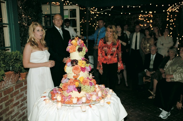 wedding cake decorated with bright flowers