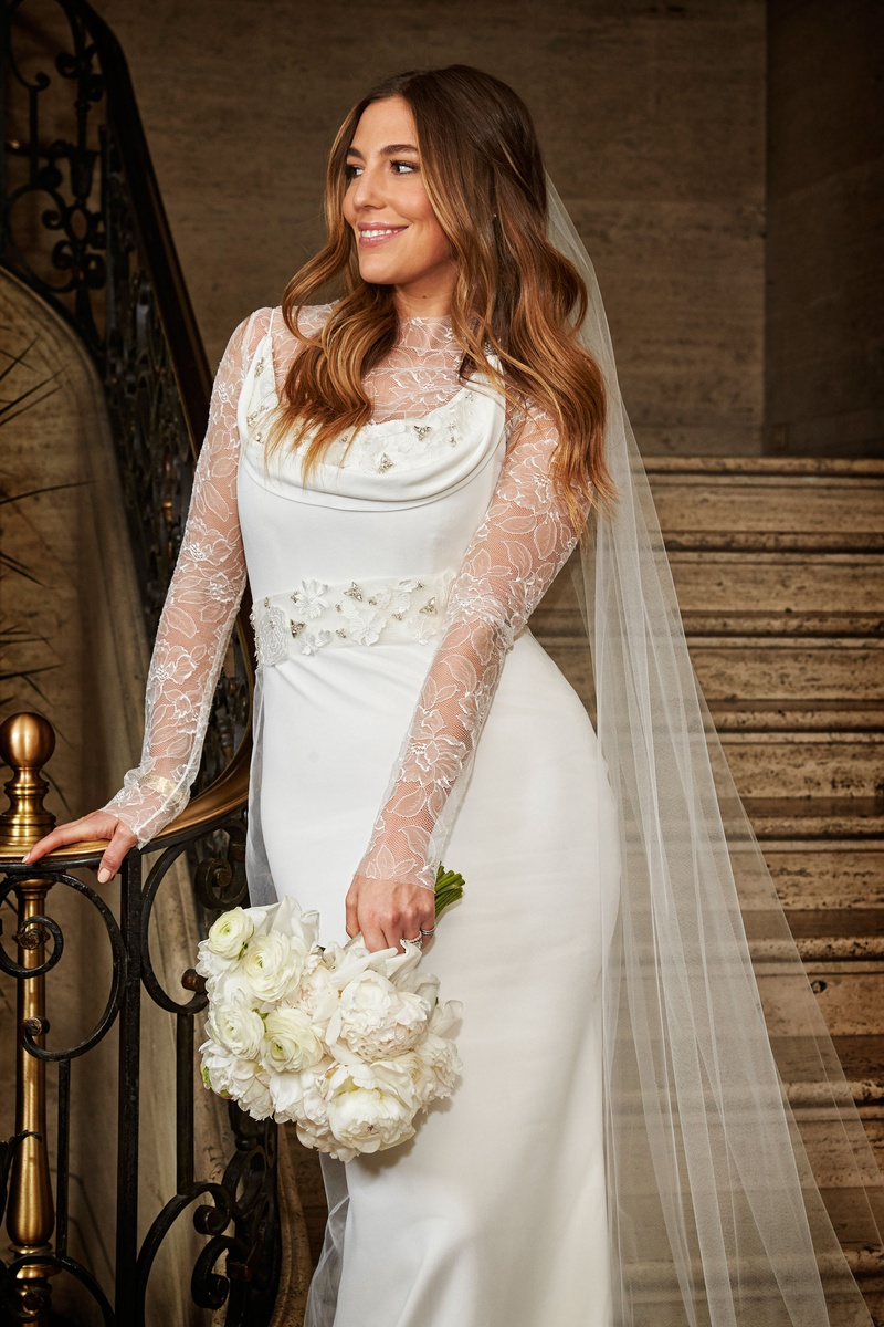 bride with hair down loose curls veil vera wang cowl neck wedding dress over lace body suit unique