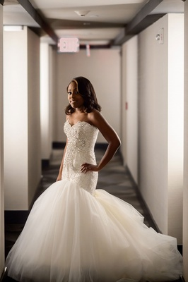 African American bride in strapless trumpet bridal gown with embellished beaded strapless bodice
