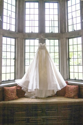brides gorgoeus white w-line gown with sweetheart neckline hanging in the window