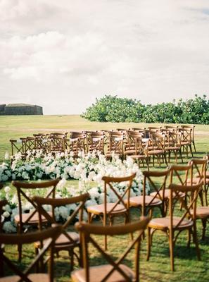 mariana paola vicente and kike hernandez puerto rico wedding ceremony wood vineyard chairs flowers