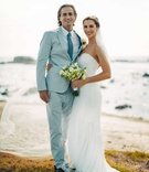 bride groom pose beach blue suit green bouquet mexico sweetheart gown Pacific Ocean wedding