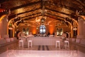 Wedding after party with white decor white dance floor bar stools tufted ottoman bench furniture