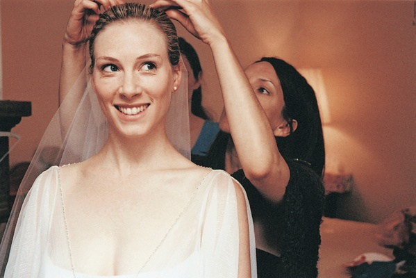 Bride gets help from friend with veil