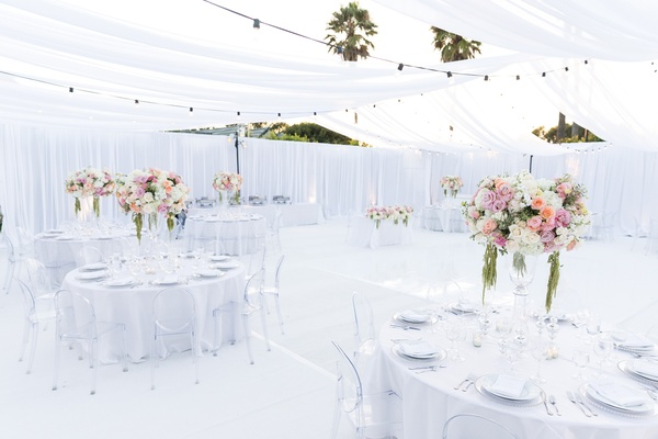 tented reception white space, pink, cream, and green centerpieces, ghost chairs
